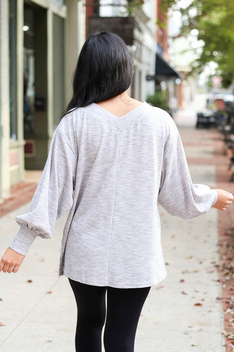 Model from Dress Up Boutique wearing the Heathered Knit Balloon Sleeve Top - Back View