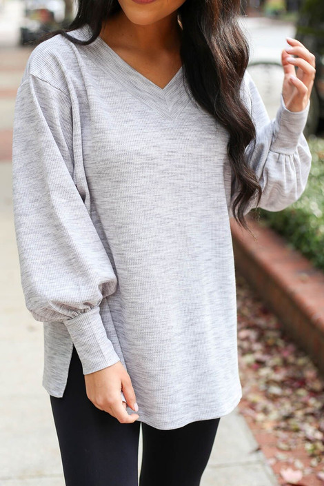 Model from Dress Up Boutique wearing the Heathered Knit Balloon Sleeve Top - Close Up View