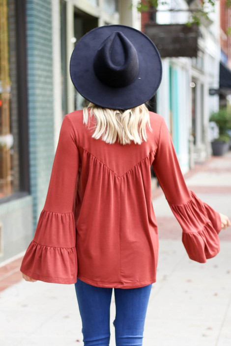 Model wearing the Rust Tiered Bell Sleeve Top from Dress Up Boutique - Back View