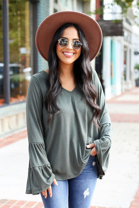 Model wearing the Olive Tiered Bell Sleeve Top from Dress Up Boutique - Front View