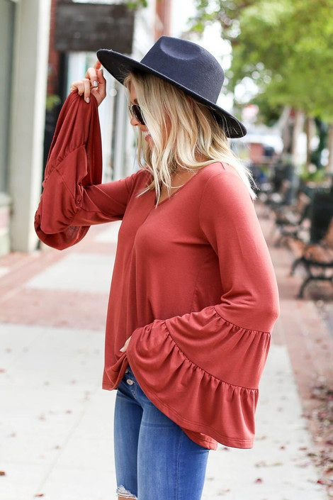 Model wearing the Rust Tiered Bell Sleeve Top from Dress Up Boutique - Side View