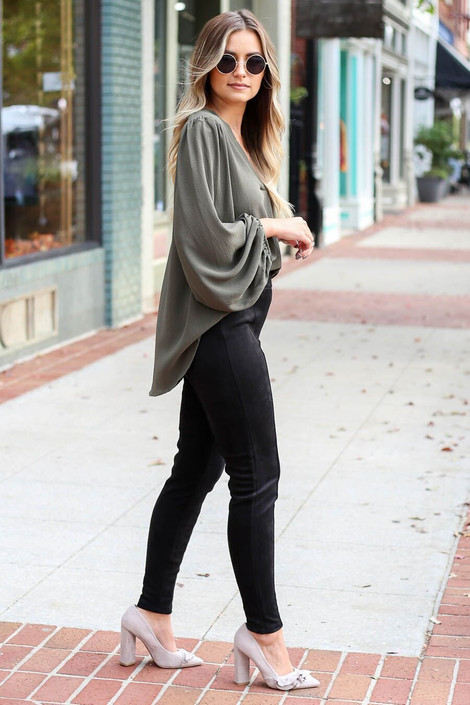 Model wearing the Black Suede Ponte Front Seam Pants from Dress Up Boutique - Side View