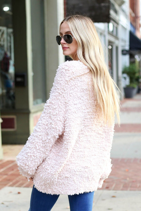 Model wearing the Blush Fuzzy Popcorn Knit Oversized Sweater from Dress Up Boutique - Back View