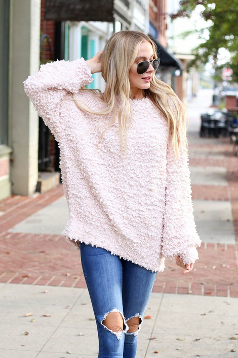 Model wearing the Blush Fuzzy Popcorn Knit Oversized Sweater from Dress Up Boutique - Front View