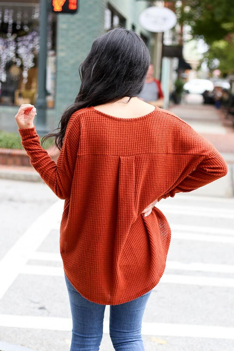 Dress Up Model wearing the Pocketed Waffle Knit Top in Rust - Back View