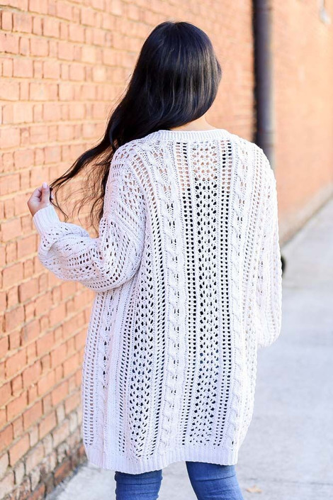 Model wearing the Button Front Cable Knit Cardigan Sweater from Dress Up - Back View