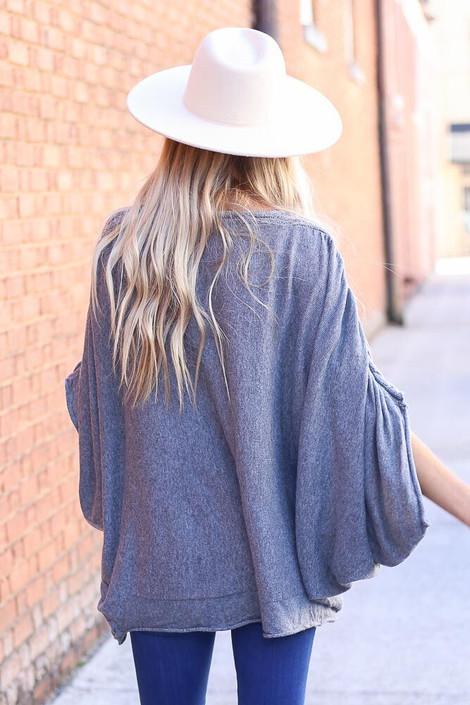 Model wearing Cable Knit Doleman Sleeve Top from Dress Up Back View