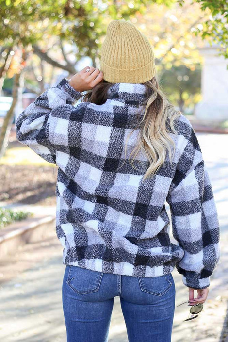 Model wearing the Nina Sherpa Buffalo Plaid Quarter Zip Pullover from Dress Up Boutique - Back View