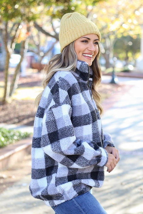 Model wearing the Nina Sherpa Buffalo Plaid Quarter Zip Pullover from Dress Up Boutique - Side View