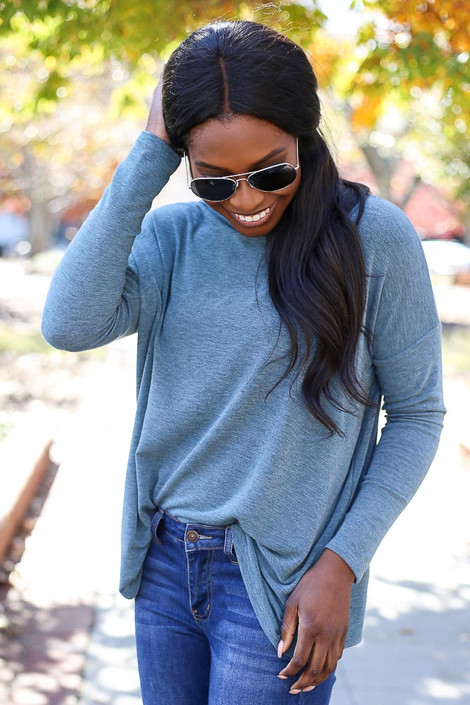 Dress Up Model wearing Teal Heather Knit Oversized Top Tucked In