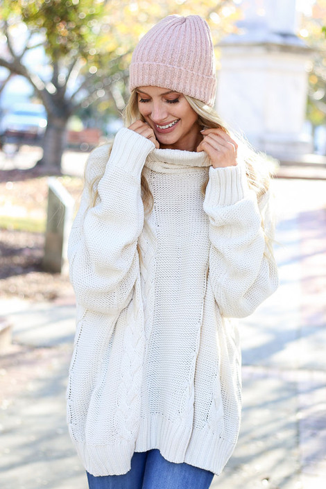 Ivory - Sienna Cable Knit Oversized Sweater on Model  Front with Sage Ribbed Beanie