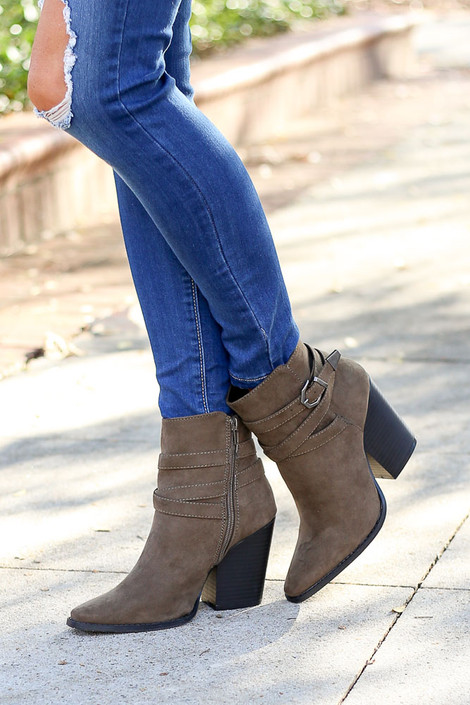 Model wearing the Khaki Buckled Ankle Booties stacked heel