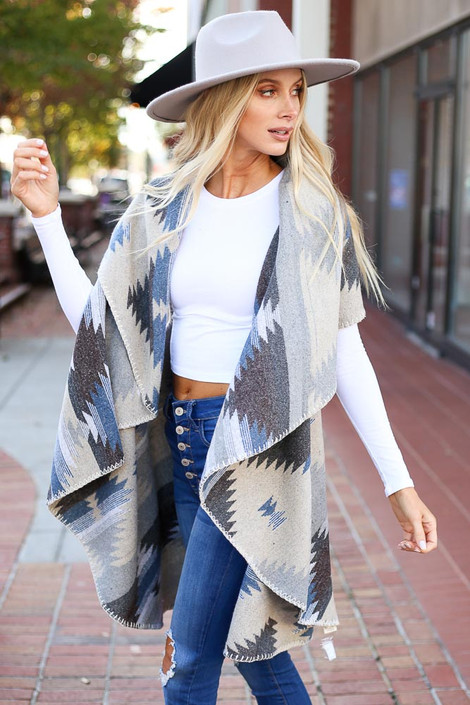 Dress Up Model wearing Taupe Aztec Print Vest Side View