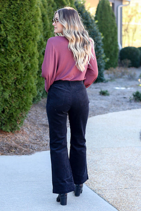 Model wearing the Black Corduroy Tie Waist Pants with blouse from Dress Up Back View