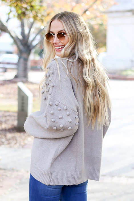 Model wearing the Mock Neck Pom Pom Sweater from Dress Up Boutique in Grey - Back View