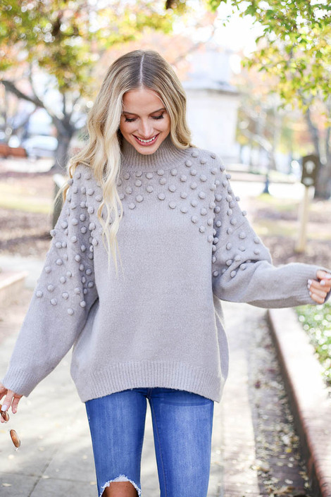 Model wearing the Mock Neck Pom Pom Sweater from Dress Up Boutique in Grey - Front View