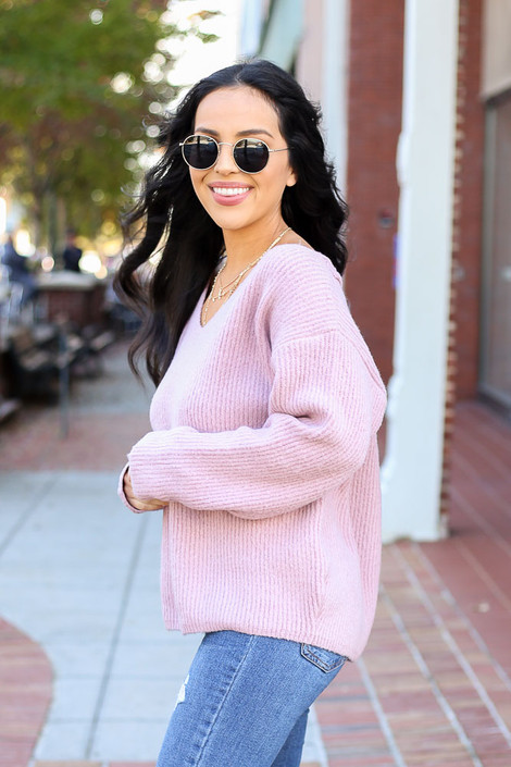 Model wearing Blush Lace Up Back Sweater Side View