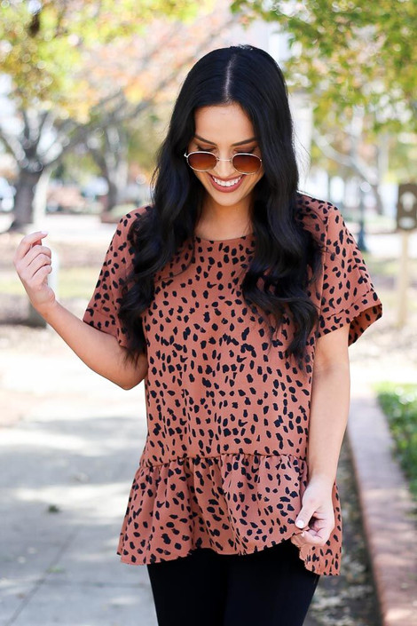 Model of Dress Up wearing the Camel Spotted Ruffle Hem Blouse - Front View