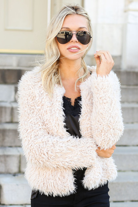 Dress Up Model wearing Ivory Cropped Faux Fur Jacket