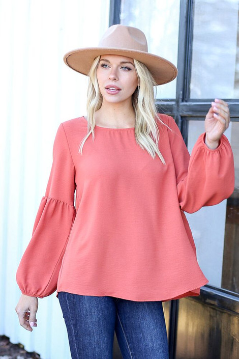 Model from Dress Up wearing the Tiered Sleeve Blouse in Rust - Front View
