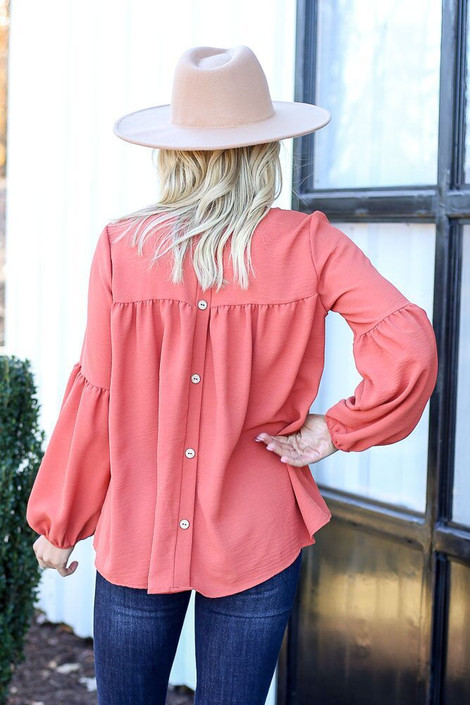 Model from Dress Up wearing the Tiered Sleeve Blouse in Rust - Back View