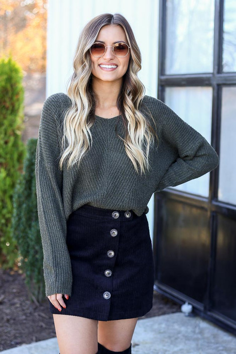 Dress Up Model wearing Black Button Front Corduroy Mini Skirt