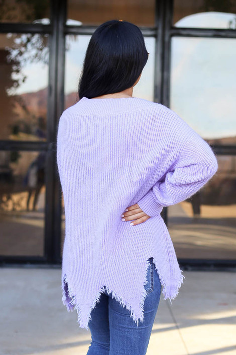 Lilac - Back view of a distressed hem sweater