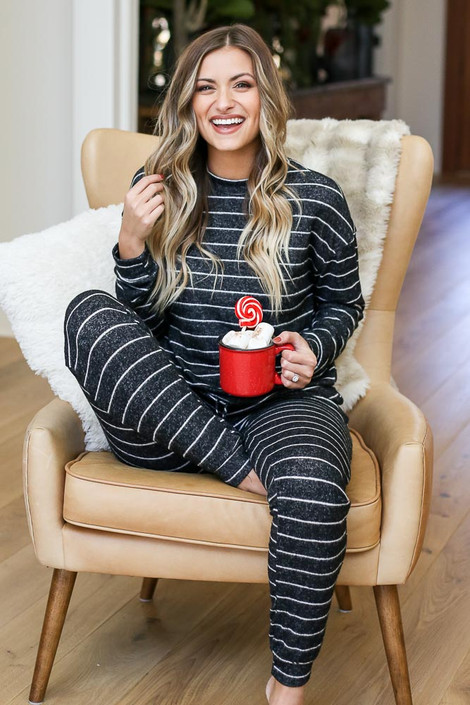 Black - Striped Fleece Joggers Sitting View