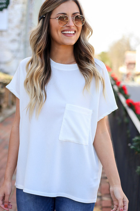 White - Dress Up Model wearings a white t-shirt with dark wash denim