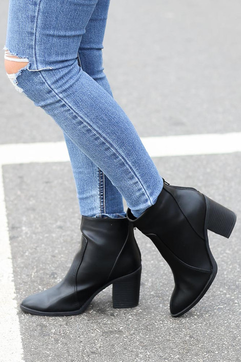 Black - Model wearing black vegan leather block heel ankle booties