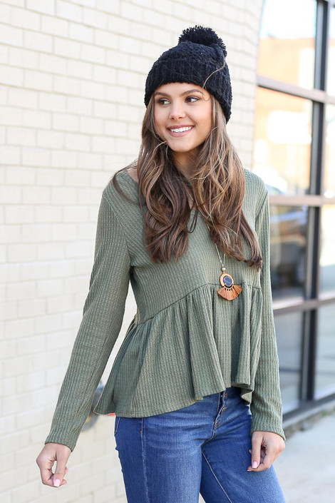 Green - Model wearing a olive green waffle knit top with a black hat