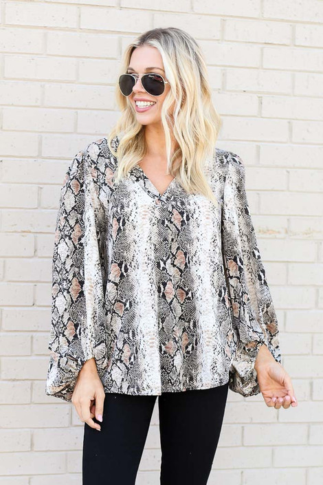 Model wearing the Snakeskin Balloon Sleeve Blouse from Dress Up with Black Skinny Jeans