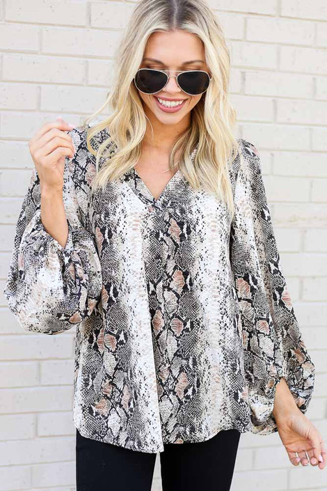 Model from Dress Up wearing the Snakeskin Balloon Sleeve Blouse with Black Skinny Jeans