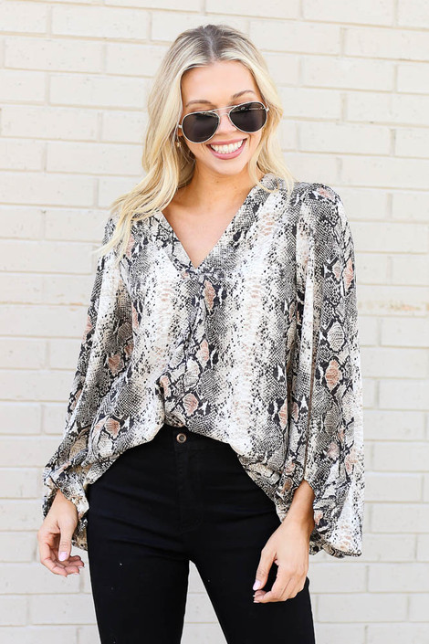 Model from Dress Up wearing Snakeskin Balloon Sleeve Blouse with Black Skinny Jeans Front View