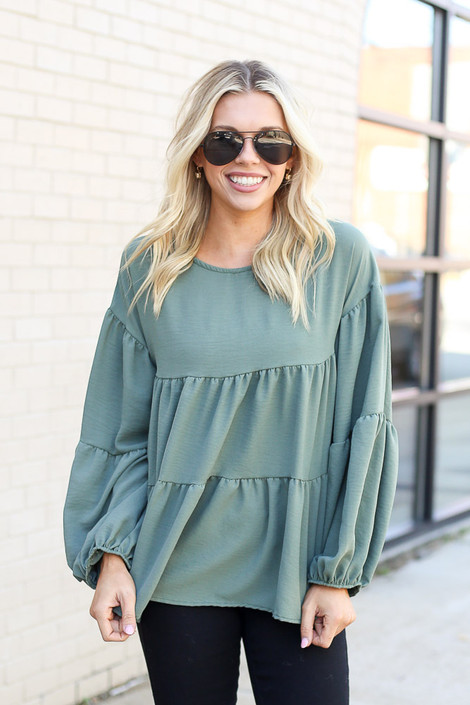 Model wearing the Tiered Babydoll Blouse in Olive from Dress Up Front View