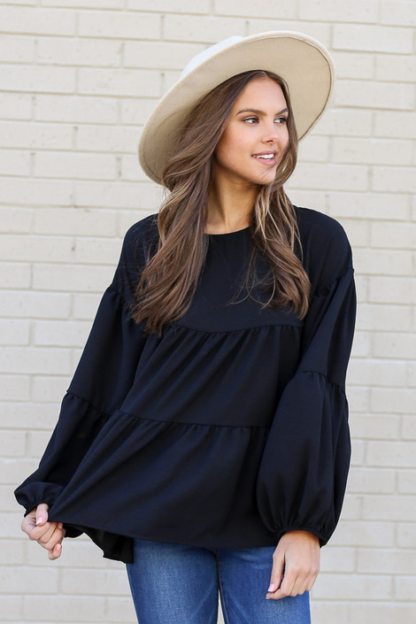 Model wearing the Tiered Babydoll Blouse in Black from Dress Up Front View