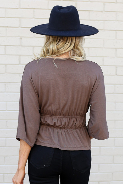 Model of Dress Up wearing the Smocked Surplice Top in Mocha Back View