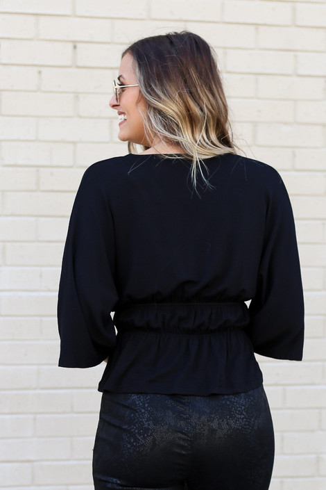 Model of Dress Up wearing the Smocked Surplice Top in Black Back View