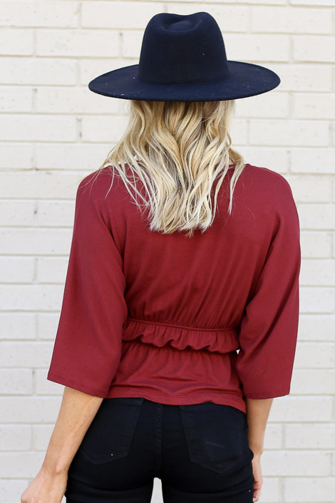 Model of Dress Up wearing the Smocked Surplice Top in Rust Back View