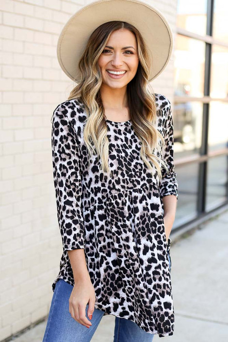 Model wearing Leopard Babydoll Tunic from DressUp with jeans and knee high boots