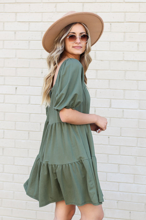 Model wearing the Olive Off the Shoulder Tiered Midi Dress from Dress Up Side View
