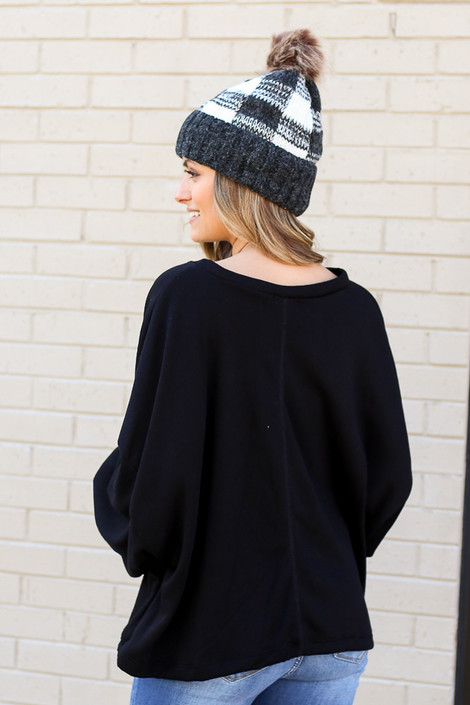 Model wearing the Be Good Pullover with buffalo plaid beanie from Dress Up Back View