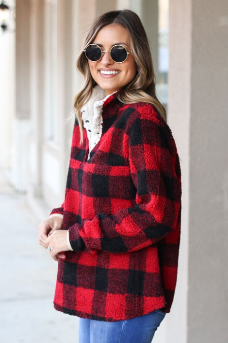 Model wearing the Buffalo Plaid Sherpa Pullover Side View
