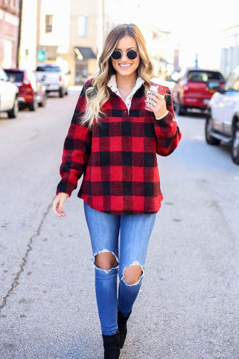 Model walking while wearing the Buffalo Plaid Sherpa Pullover Front View