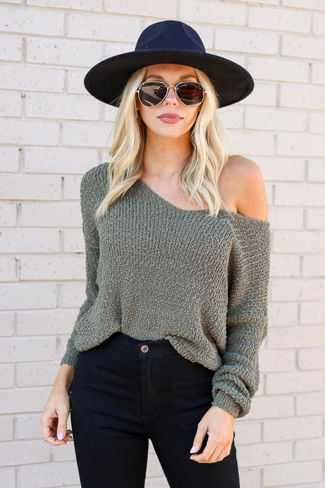 Model wearing the Open Knit Twist Back Sweater from Dress Up in Olive