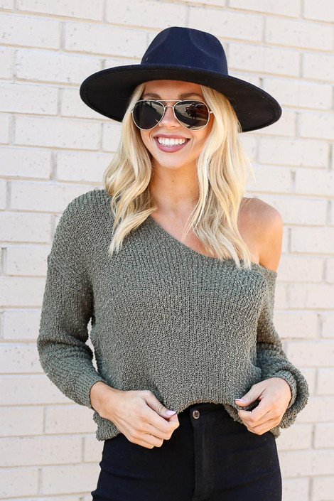 Model from Dress Up wearing the Open Knit Twist Back Sweater in Olive with black skinny jeans Front View