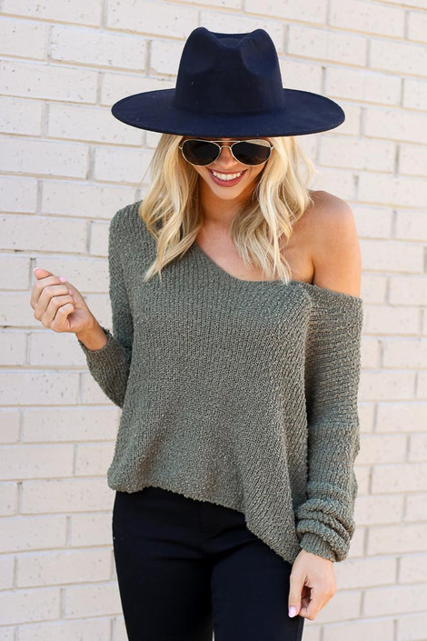 Dress Up Model wearing the Open Knit Twist Back Sweater in Olive with wide brim hat Front View