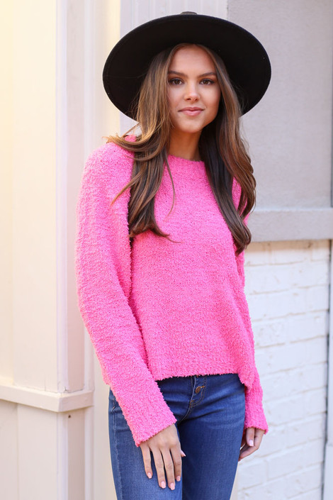 Model wearing the Fuzzy Knit Sweater from Dress Up in Neon Pink Front View