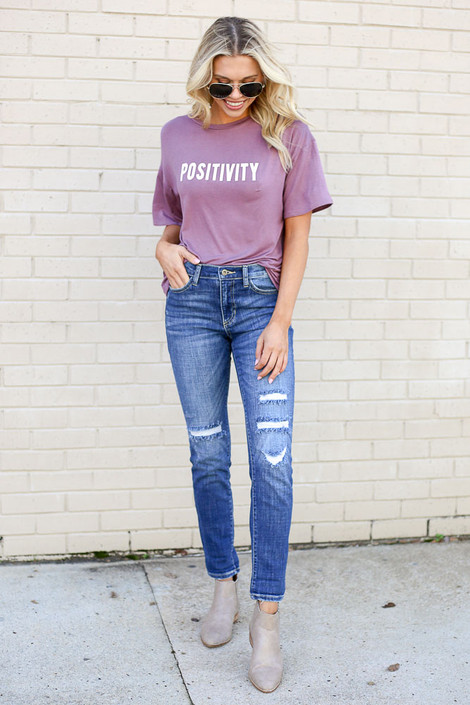 Model wearing the Medium Wash High Rise Distressed Skinny Jeans with Graphic Tee  from Dress Up