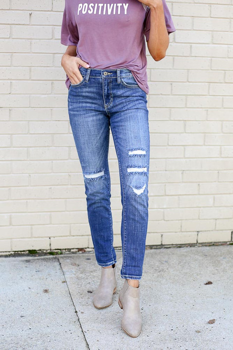 Model wearing the Medium Wash High Rise Distressed Skinny Jeans from Dress Up Close Up